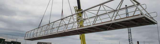 Bridge-lifted-into-place-as-challenging-marina-project