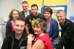 Rhys Williams from Jones Bros is pictured with Julie Helena Williams, Renal Transplant Specialist Nurse at the Wrexham Maelor Hospital. Back (left to right), Iona Jones, fund-raiser from Jones Bros; Stuart Robertson, Consultant Physician; Huw Issac and Sharon Lewis, fund-raisers from Jones Bros and David Glover, Consultant Physician