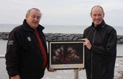 Mike Stevens (right) presents a framed photograph to Dilwyn Davies